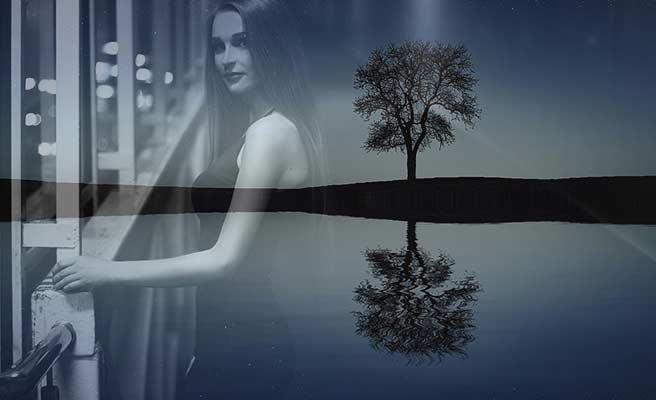 女性と湖岸に立つ木