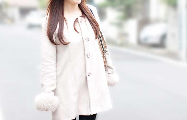 素敵なコートを着た女性
