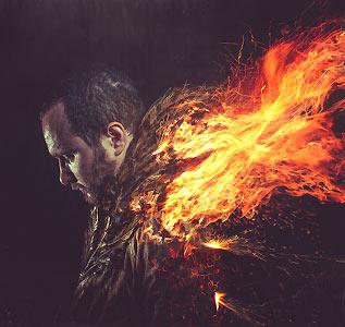 炎をまとった男性