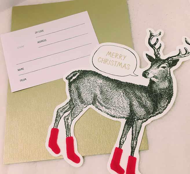 鹿の切り抜きイラストがついたカード