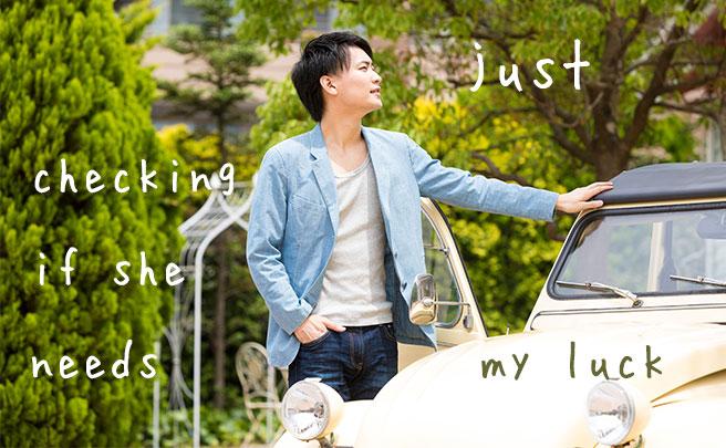 車で女性を待ってる男性